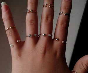 gold, hand, and piercing image