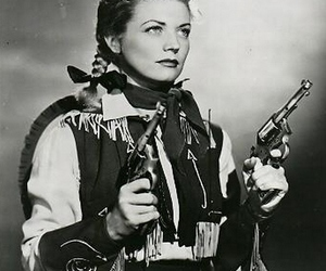 Cowgirl, guns, and makeup image
