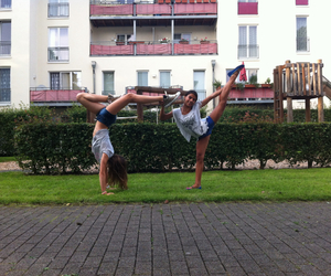 cheer, handstand, and two girls image
