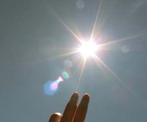sun, hand, and sky image