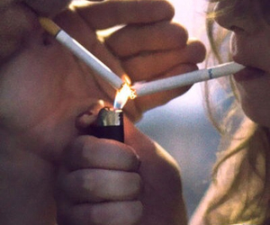 blonde, cigarette, and fire image