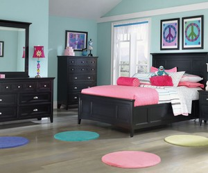 white bed, white cabinet, and colorful cushions image