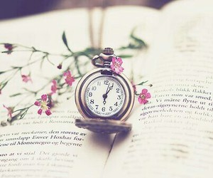 book, clock, and flowers image