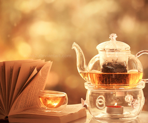 tea, book, and candle image