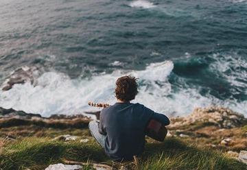 guitar, boy, and sea image
