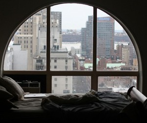 city, window, and bed image