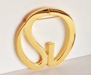 pin, st. john vintage brooch, and gold logo jewelry image