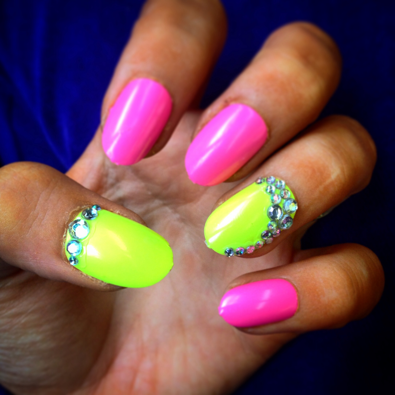 Neon pink nails with neon yellow accent nail & Swarovski crystals