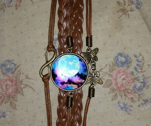 bracelet, galaxy, and lonely image