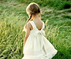 child and grass image