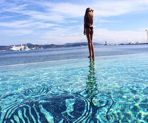 girl, water, and bikini image