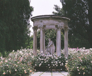 flowers, garden, and statue image