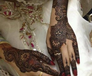 mehendi, henna, and hands image