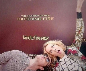 jena malone, sam claflin, and catching fire image