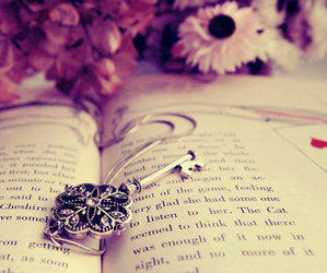 book, key, and flowers image
