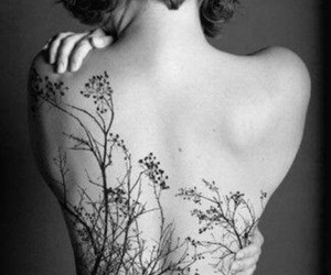 back, piercing, and Tattoos image