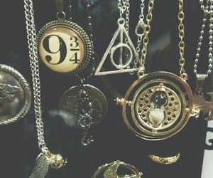 harry potter, necklaces, and timeturner image