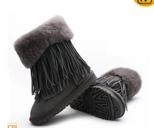 sheepskin fringe boots image