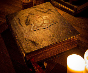 book, candle, and charmed image