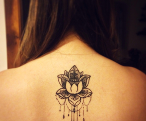 ink, lotus, and tattoo image