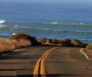 road, beach, and sea image