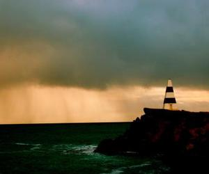 clouds, dark, and lighthouse image