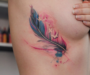 feather and tattoo image