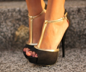 black, gold, and heels image