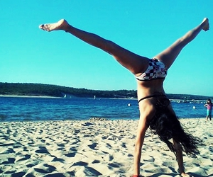gymnast, sand, and water image