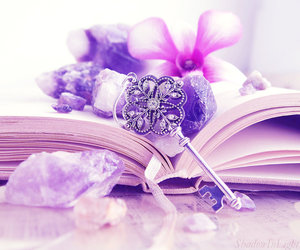 key, book, and flowers image