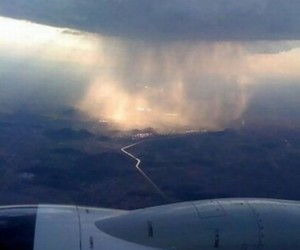 rain, clouds, and plane image