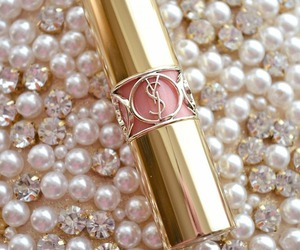 pearls, lipstick, and YSL image