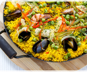 rice, seafood, and paella image