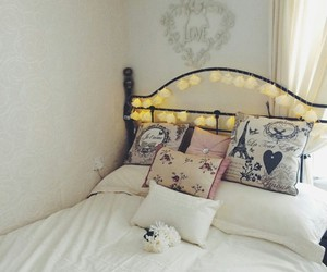 pillows, white flowers, and white bedrooms image
