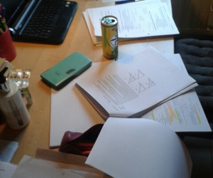 energy drink, laptop, and notes image