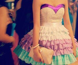 purple dress, gold accesories, and multi color dress image