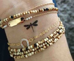 tattoo, dragonfly, and bracelet image