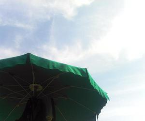 clouds and beach umbrella image