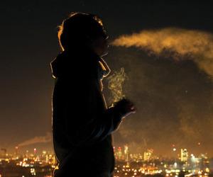 boy, smoke, and city image