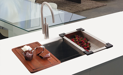 Kitchen. The Beautiful Sink With Cutting Board In The ...