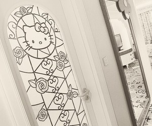 black and white and hello kitty image