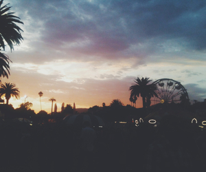 sunset, ferris wheel, and palm trees image