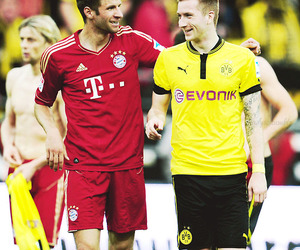 thomas muller, marco reus, and germany image
