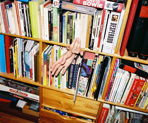 books and hand image