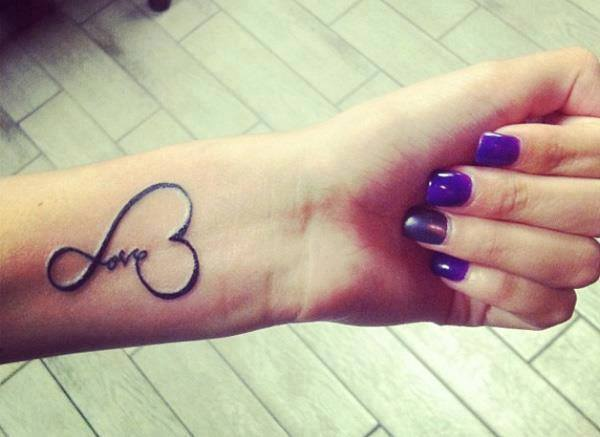 Little Tattoo Saying Love Surrounded By A Heart Shape