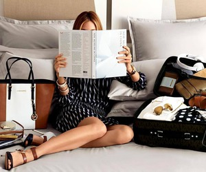 Michael Kors, reading, and travel image