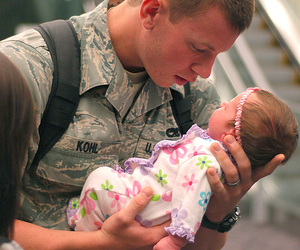 baby, soldier, and war image