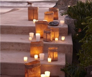 candle, beach, and light image