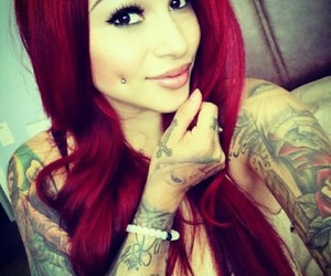 red hair and tattoo image