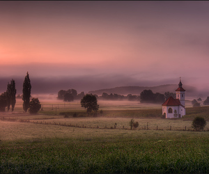 church, field, and fog image